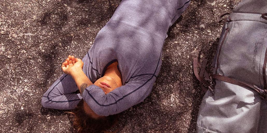 Woman wearing grey Macpac organic cotton tee